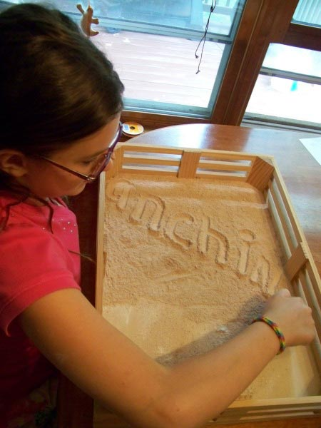 Spelling words on a flour tray