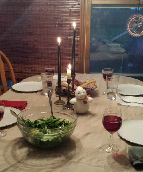 Family dinner by candlelight