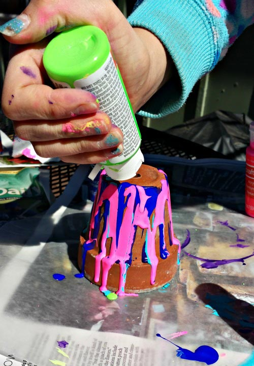 Easy Mothers Day craft and gift idea - rainbow painted pots with flowers!