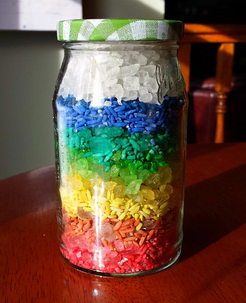 Create a Rainbow in a Jar while building fine motor skills with kids