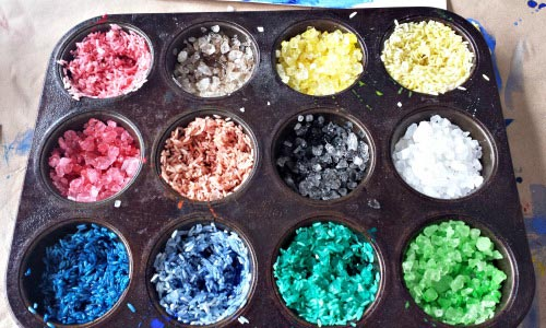 Rainbow Rice and Rock Salt - Rainbow craft activity that builds fine motor skills
